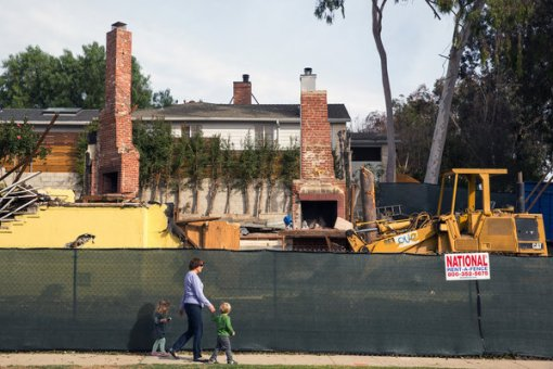 Demolished homes give way to lot filling McMansions